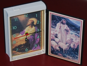 Holy Bible alarm clock fully open with pictures of Jesus to inspire you to get up.